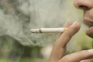 Smoking can lead to tooth loss and oral cancer